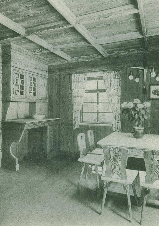 Abb. 1: Stahllamellen-Haus als Jagdhütte. In dem 1928 publizierten Gebäude ist auf der Auskleidung mit Isolierplatten eine lebhaft gemaserte Holzvertäfelung angebracht. [Spiegel 1928, S.77]